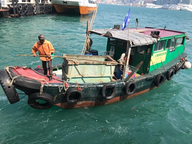 Picking up garbage on water in Hong Kong harbor. Never saw that in NYC.