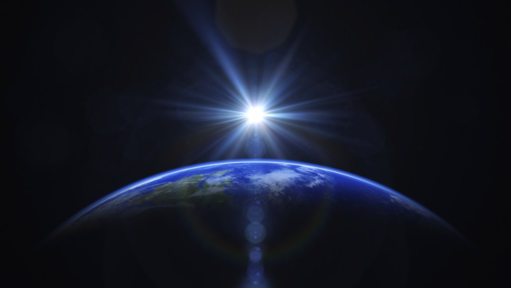 sun-over-earth-standing-on-the-earth-.jpg