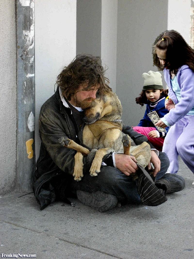 Girls-Giving-Homeless-Man-Money--87766.jpg