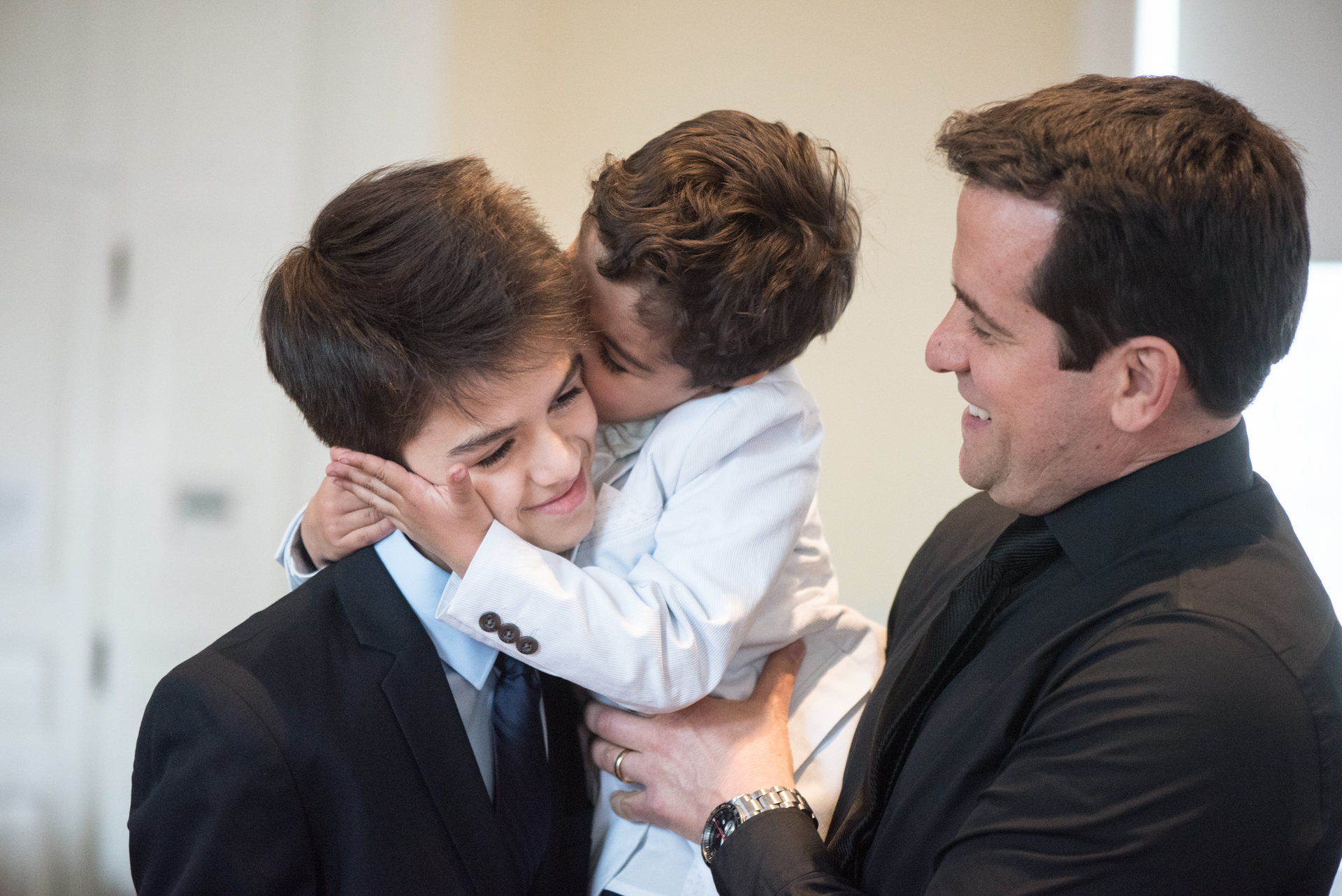 Matthew gets a kiss from Ian, with father Steve looking on.  Sometimes it's the simple moments that speak volumes.