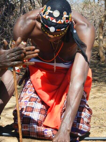 Young Maasai builds a fire. Takes all of 30 seconds. Wow!