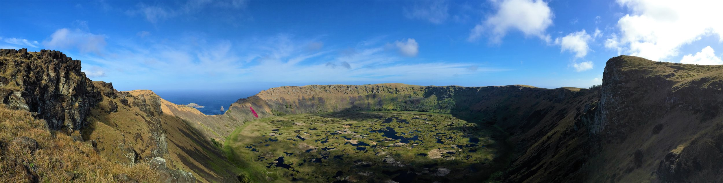 The steady, uphill climb to the rim of the Rano Kau volcanic crater lake is worth the view at the top - notice the bright-fuchsia bougainvillea just left of center!