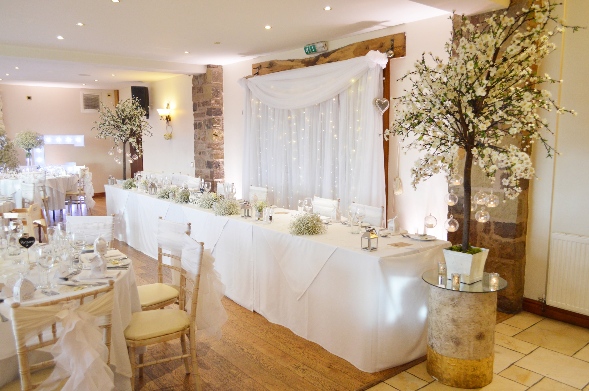 Blossom trees next to the top table