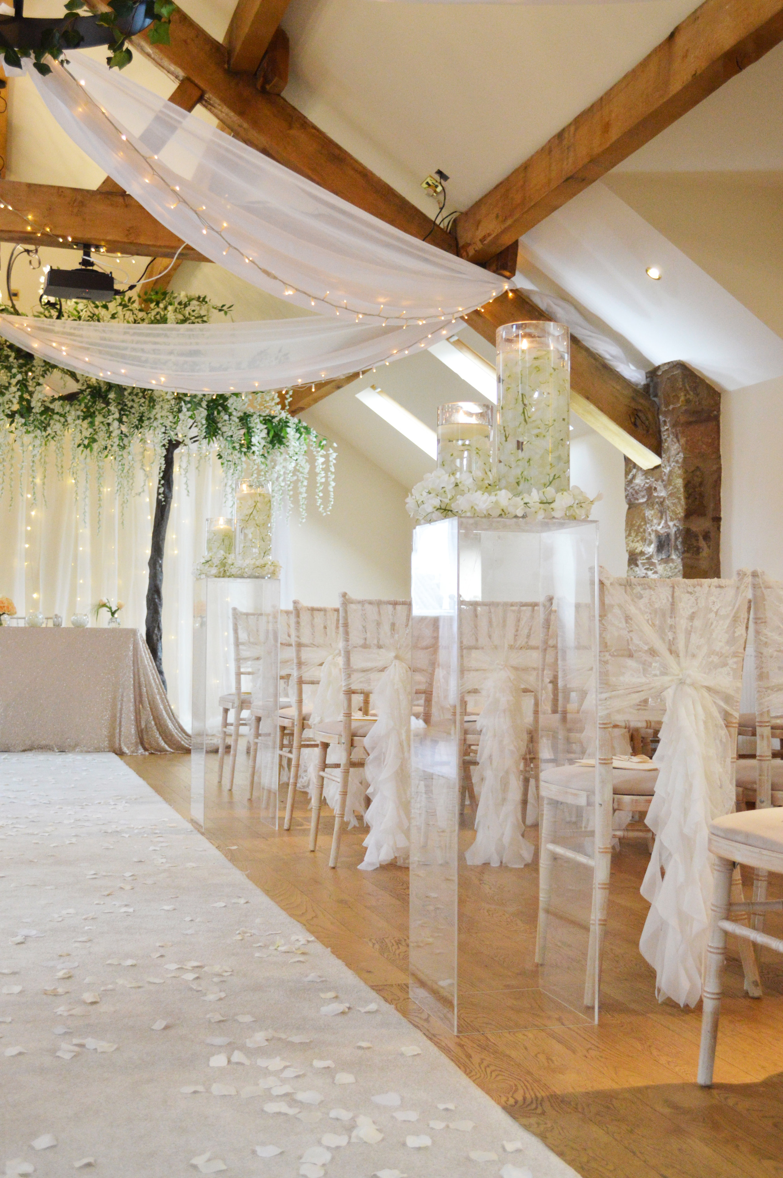 Perspex pillars with floating candles and decor