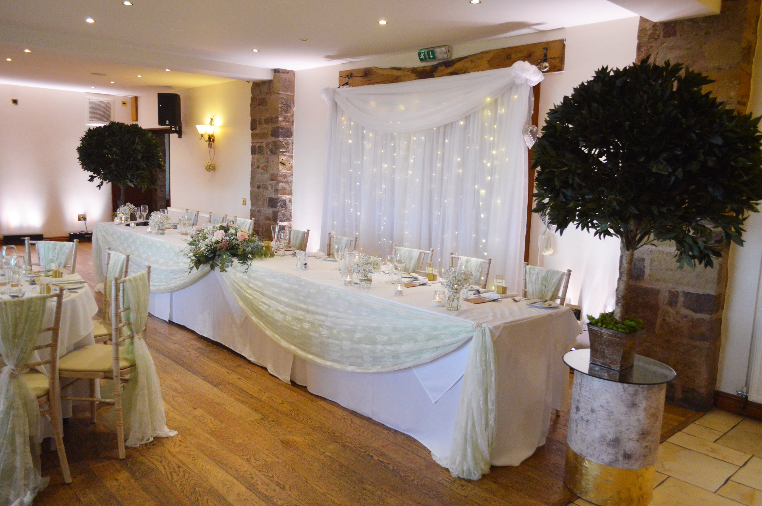 Trees next to the top table and top table drape