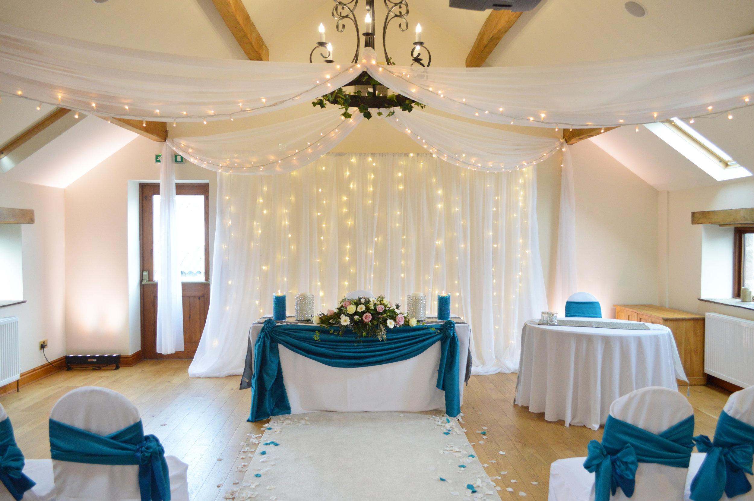 Fairy light backdrop and registrar table drape