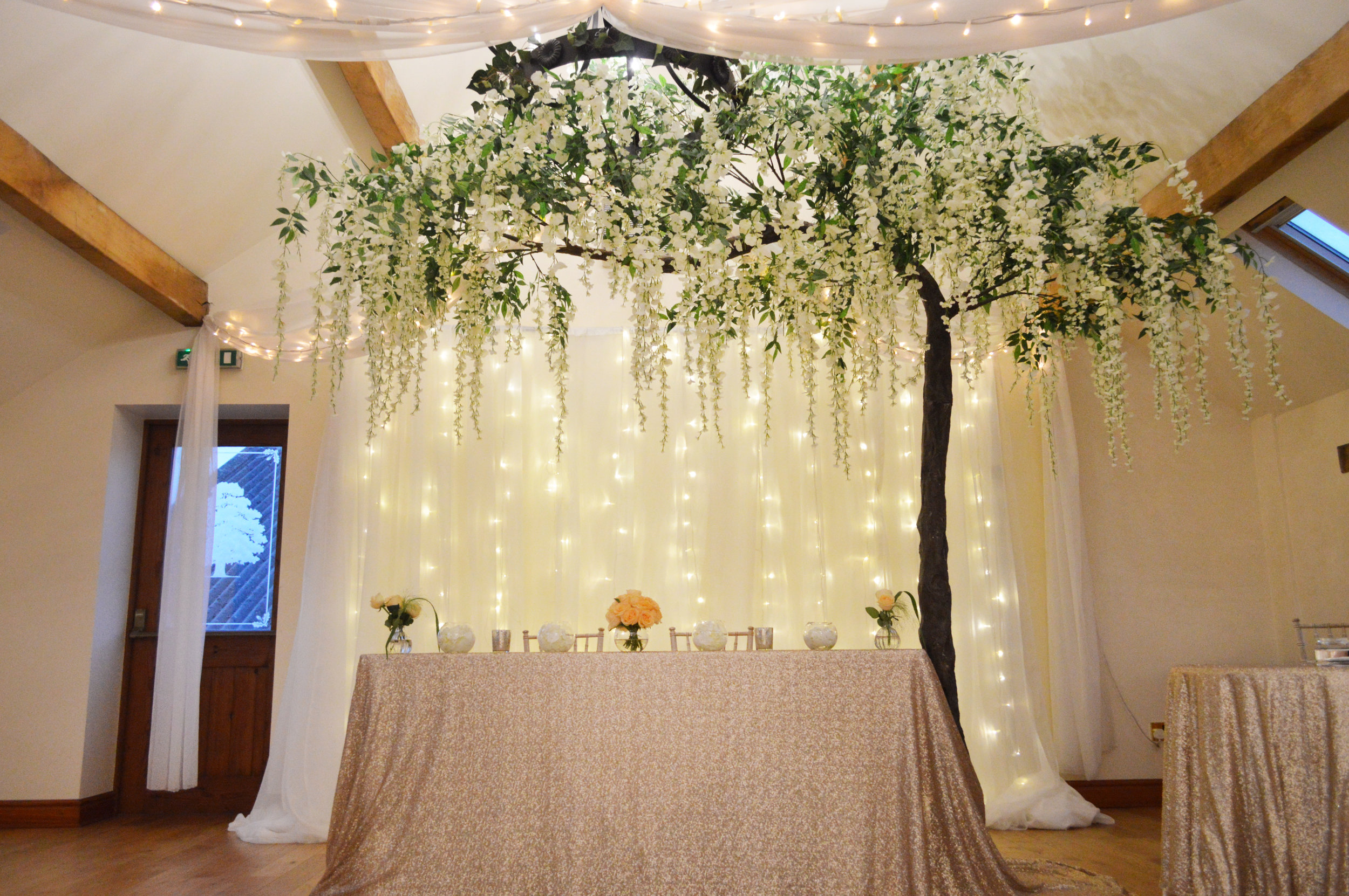 Wisteria hanging tree, registrar sequin table cloth and fairy light backdrop