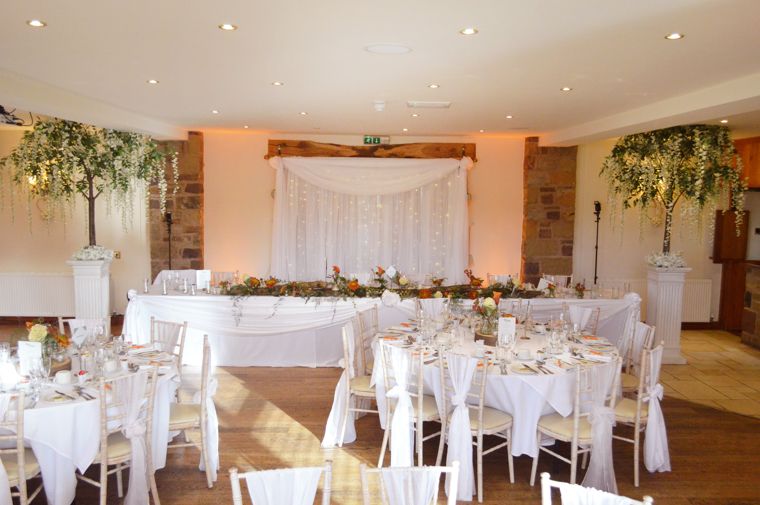 Wisteria trees next to the top table and top table drape