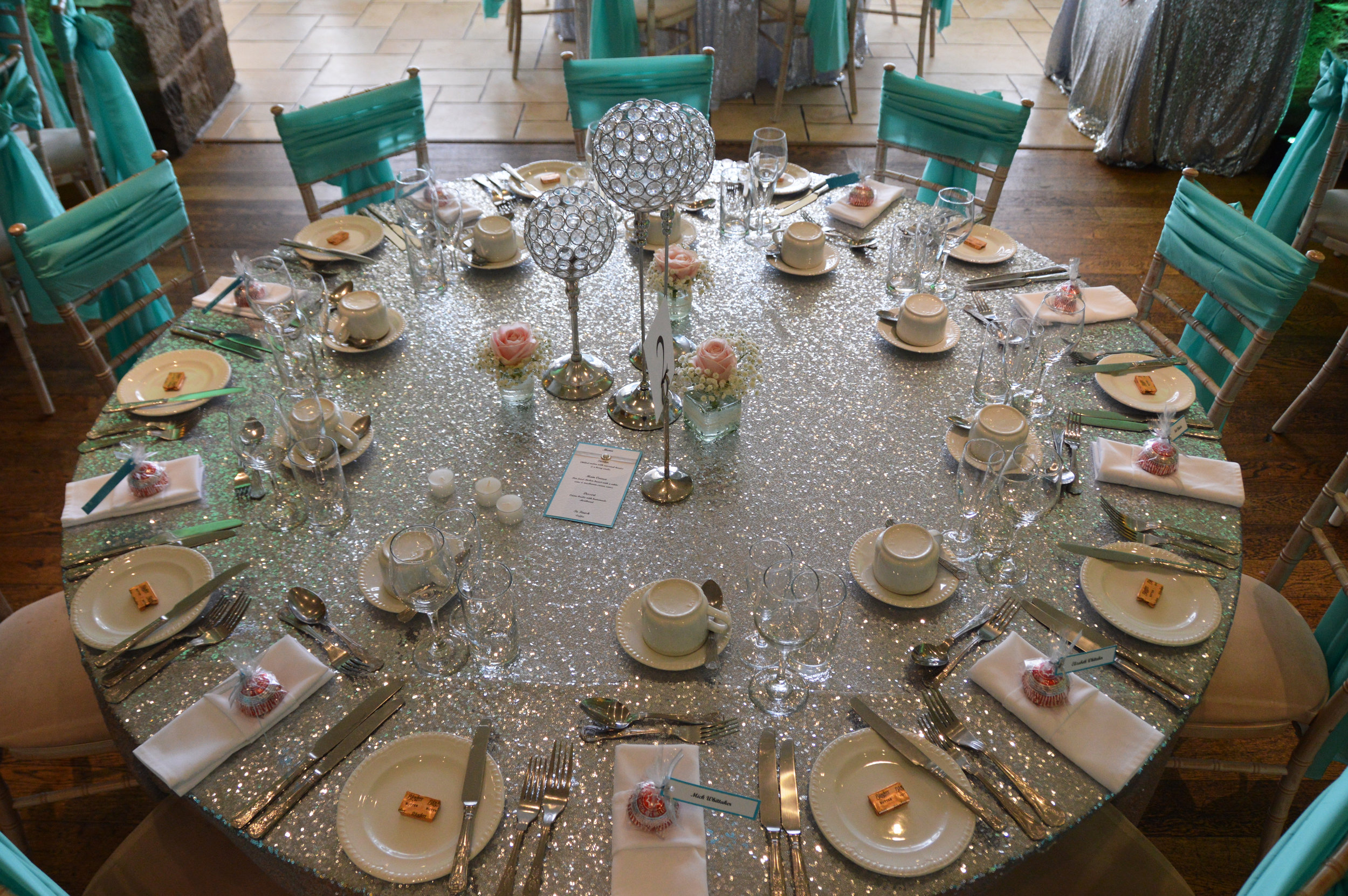 Guest table sequin table cloth and table centrepiece
