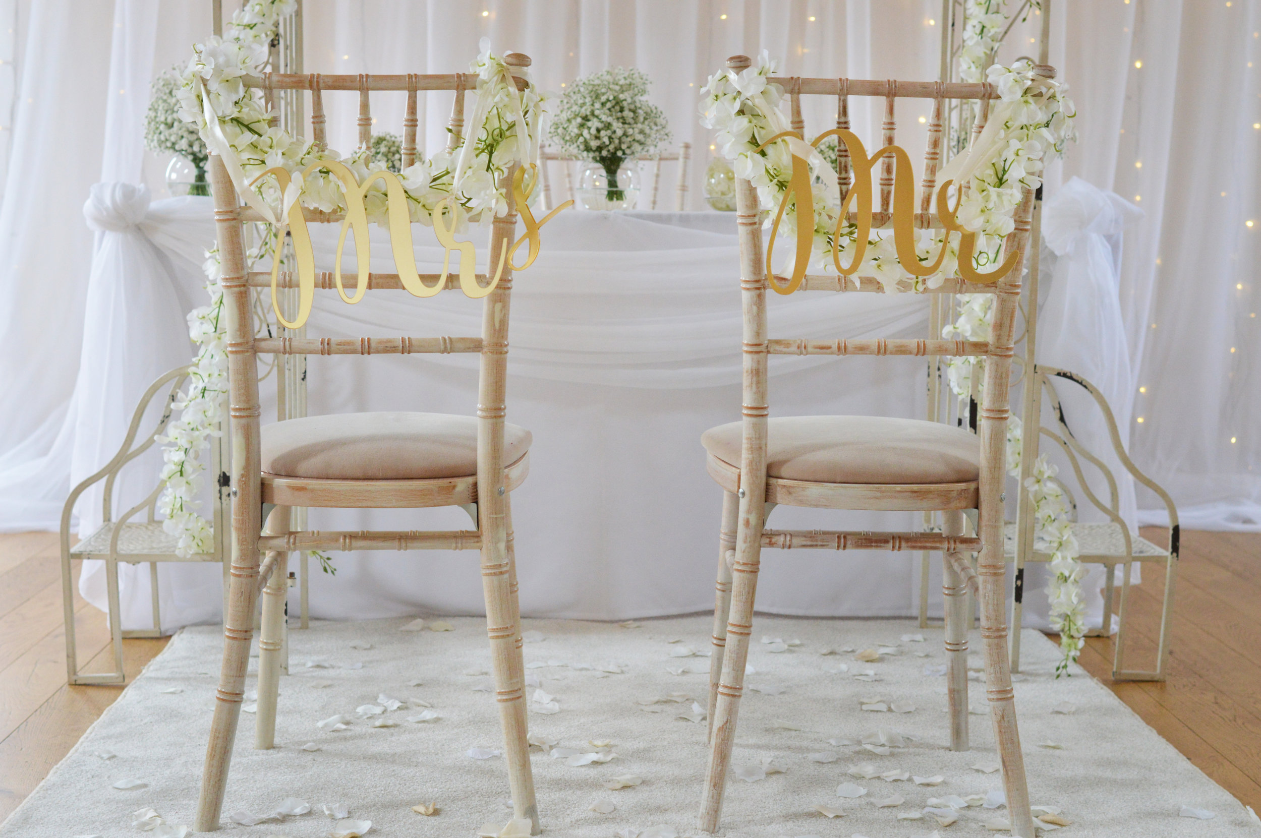 Mr & Mrs on chair with flowers