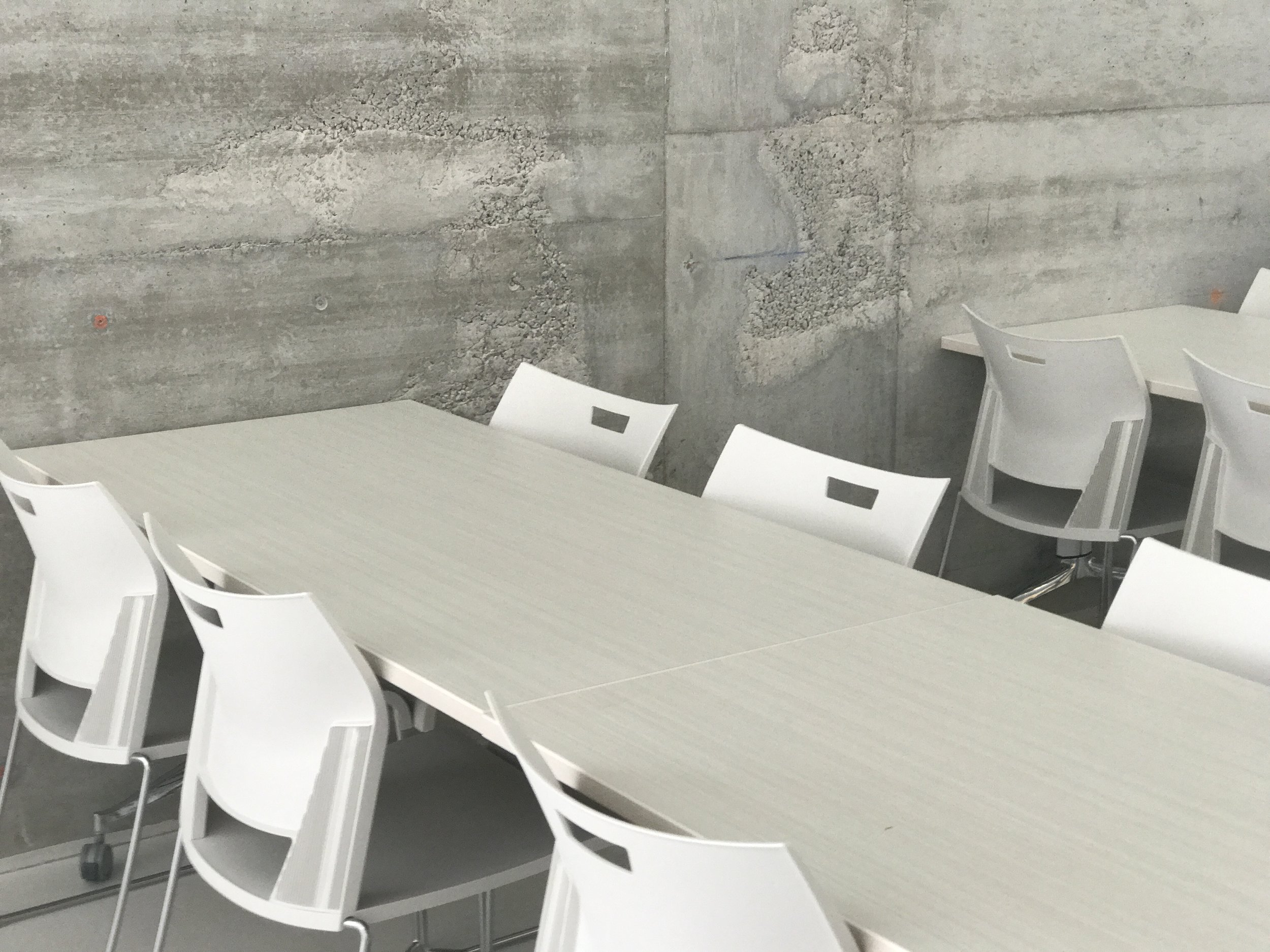 Cafe seating adjacent to a feature wall.