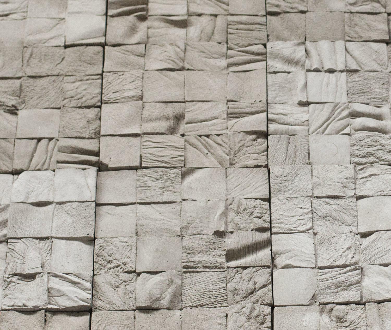 Selva Aparicio.  Tejo (Hopscotch) , 2018. Anonymous cadaver casts on concrete. 36 x 144 x 2 in.    Detail of  Tejo (Hopscotch)