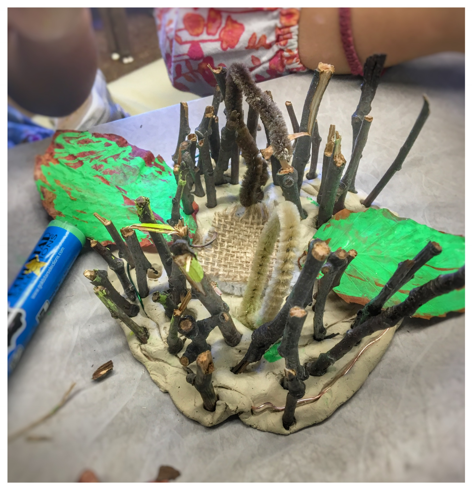 A beautiful result of an exploration with clay, wire and natural materials.