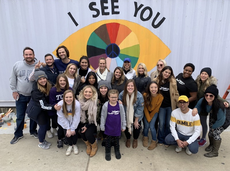 BumbleBFF, Gen and Jared Padalecki, and Xavier Schipani with Out Youth staff and board members at the  I See You Always in All Ways  mural at Container Bar in November 2018.