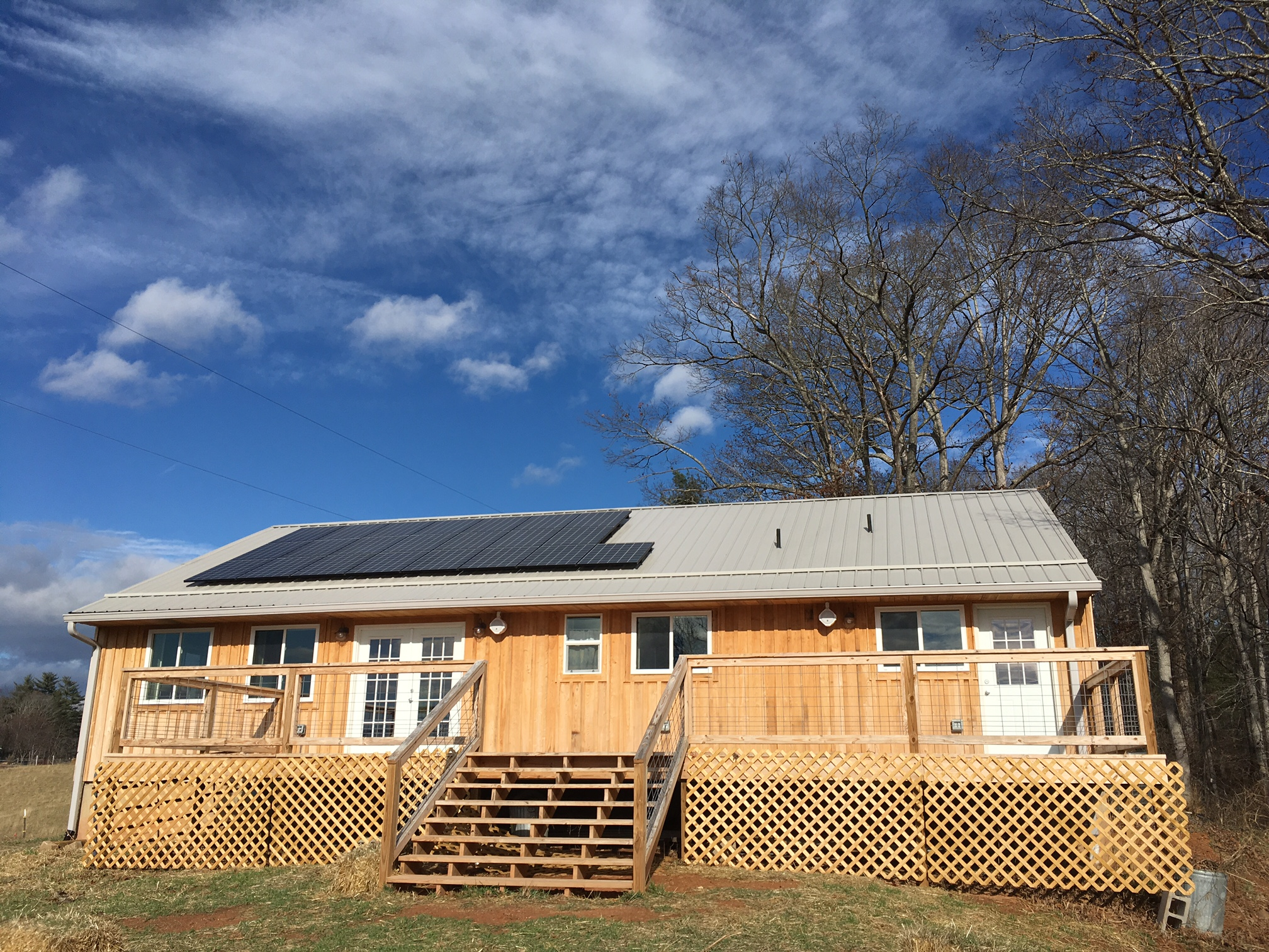 Solar Panels installed by Sugar Hollow Solar on top of the community building on SAHC's property.