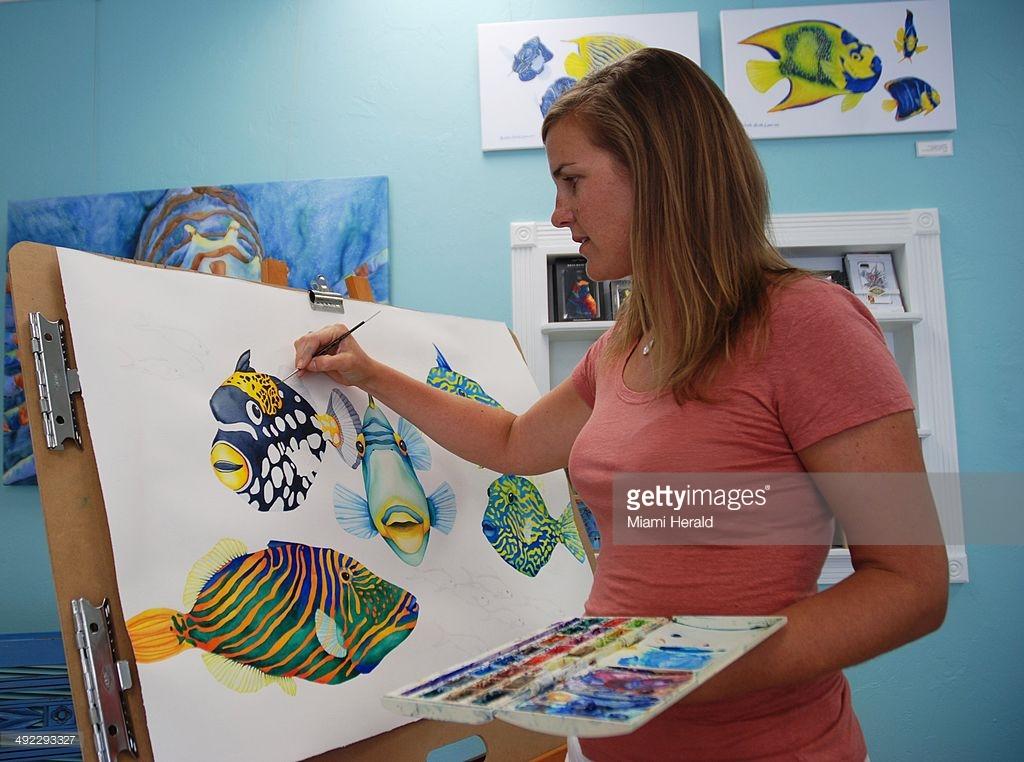 Artist Michelle Nicole Lowe paints in her Islamorada Gallery.