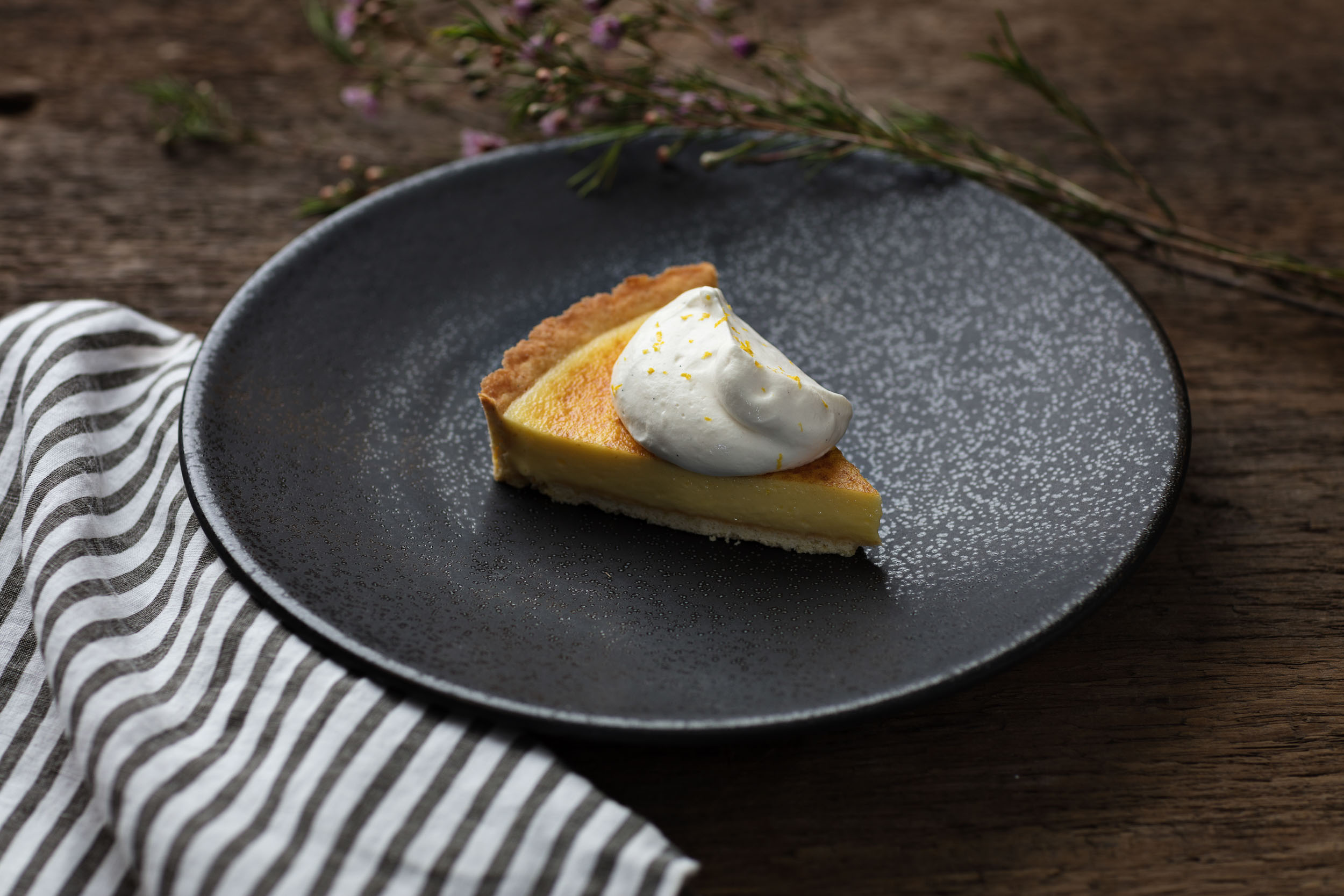Homemade pumpkin pie with hand whipped cream