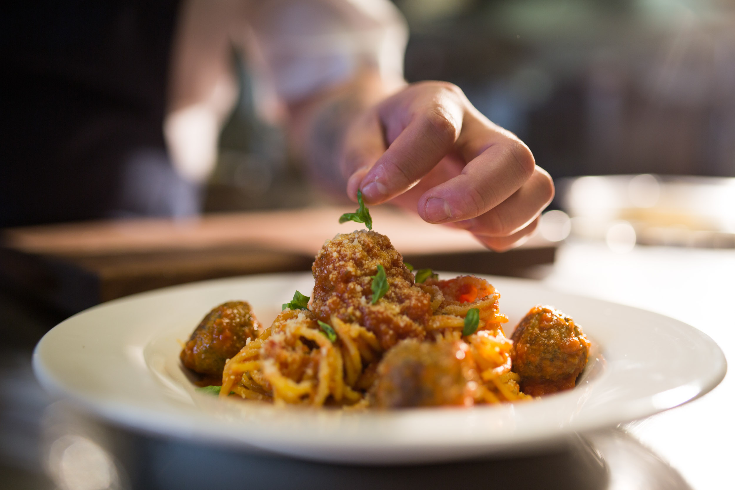 Handmade pasta with spaghetti and meatballs and microbasil