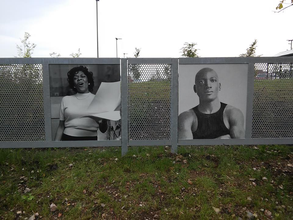 Dinah Washington and Jack Johnson on the fence along 38th and King Dr., Chicago