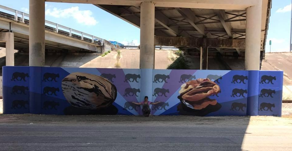 "Cristina in front of her pecan/ mountain lion mural, part of Public Art San Antonio's ""Four Seasons"" World Heritage Mural"