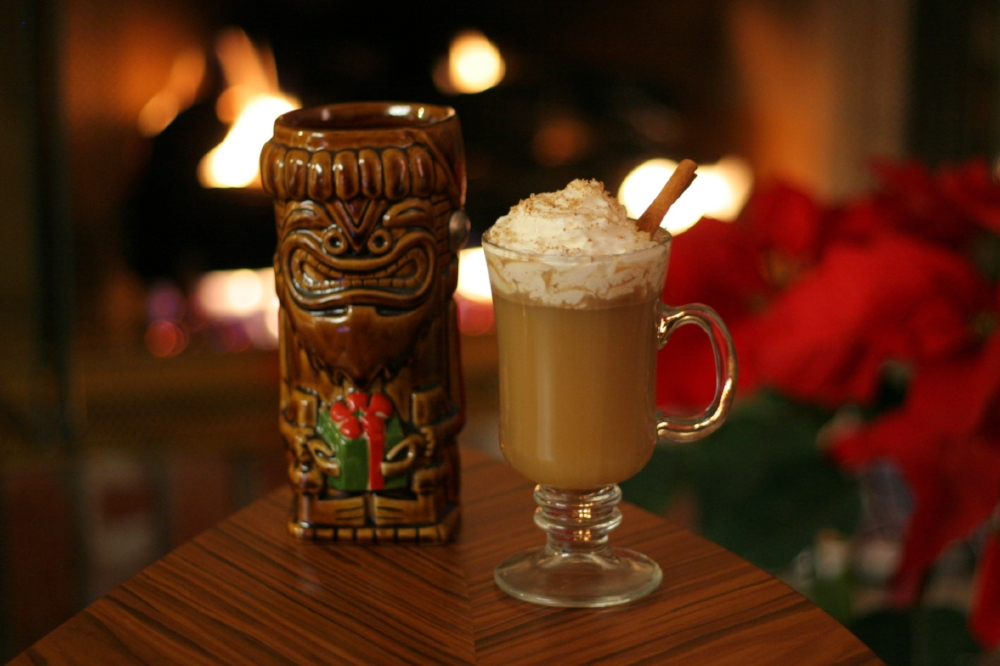 Hot Buttered Rum topped with whipped cream, freshly grated nutmeg, and garnished with a cinnamon stick. Tiki-Ti Kahuna Kalikimaka mu  g  designed by Derek Yaniger and produced by Tiki Farm.