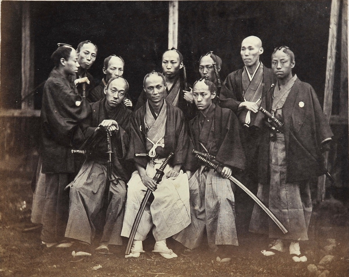 UENO Hikoma  (1838-1904) :  GROUP OF SAMURAI SCHOLARS, Nagasaki, c.1864.. Albumen print from wet collodion negative, 110 x 140 mm.