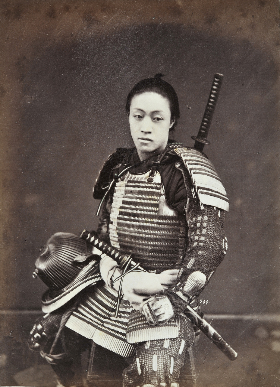 SUZUKI Shin'ichi I (1835-1919):  SUZUKI Shin'ichi I (1835-1919): Portrait of Unidentified Samurai in Armour, Yokohama, c.1873-76. Albumen print from wet collodion negative, 259 x 198 mm.g.