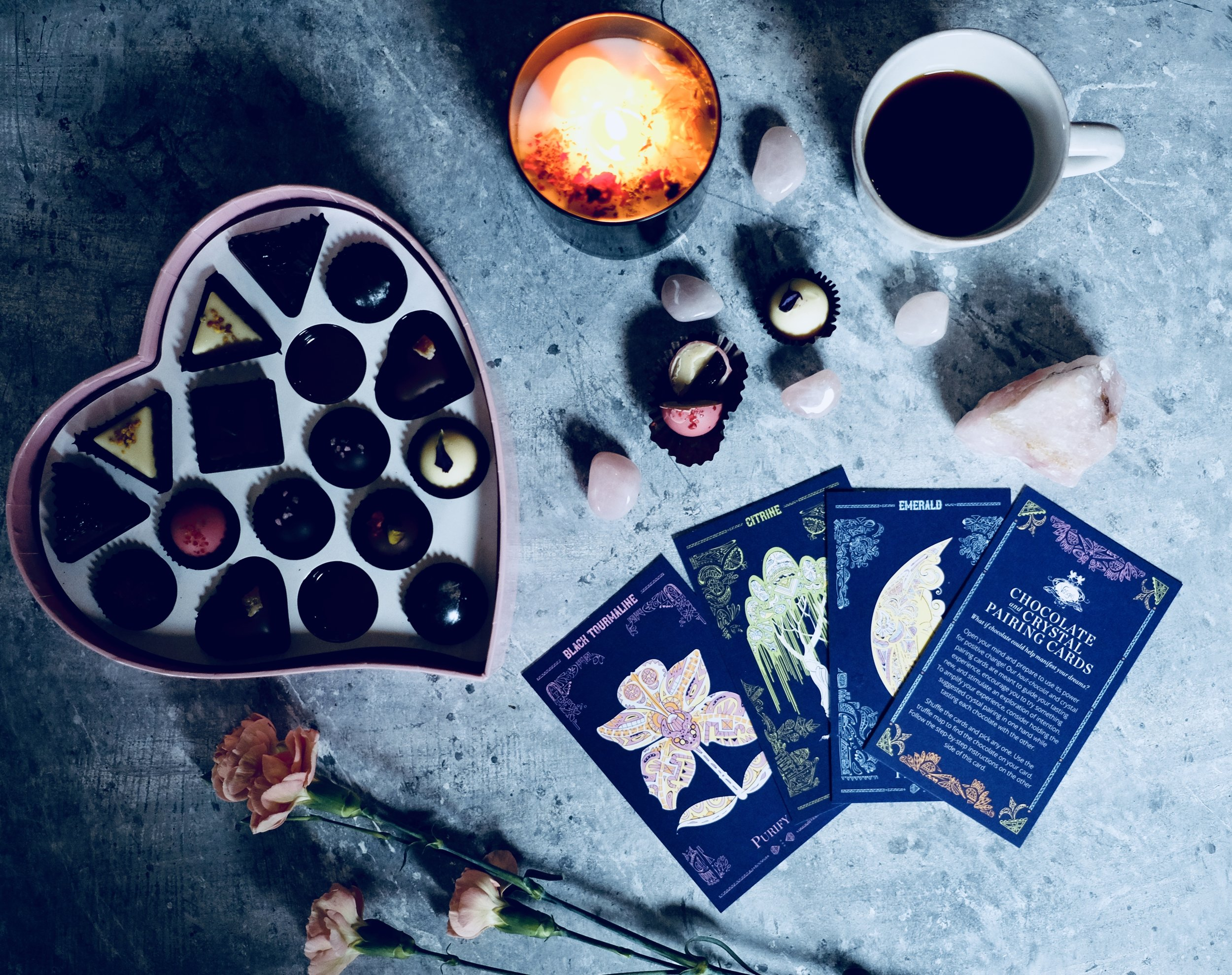 Pictured here Vosges Cosmic Heart Chocolate collection & MARVEL + MOON Tenth Muse candle.