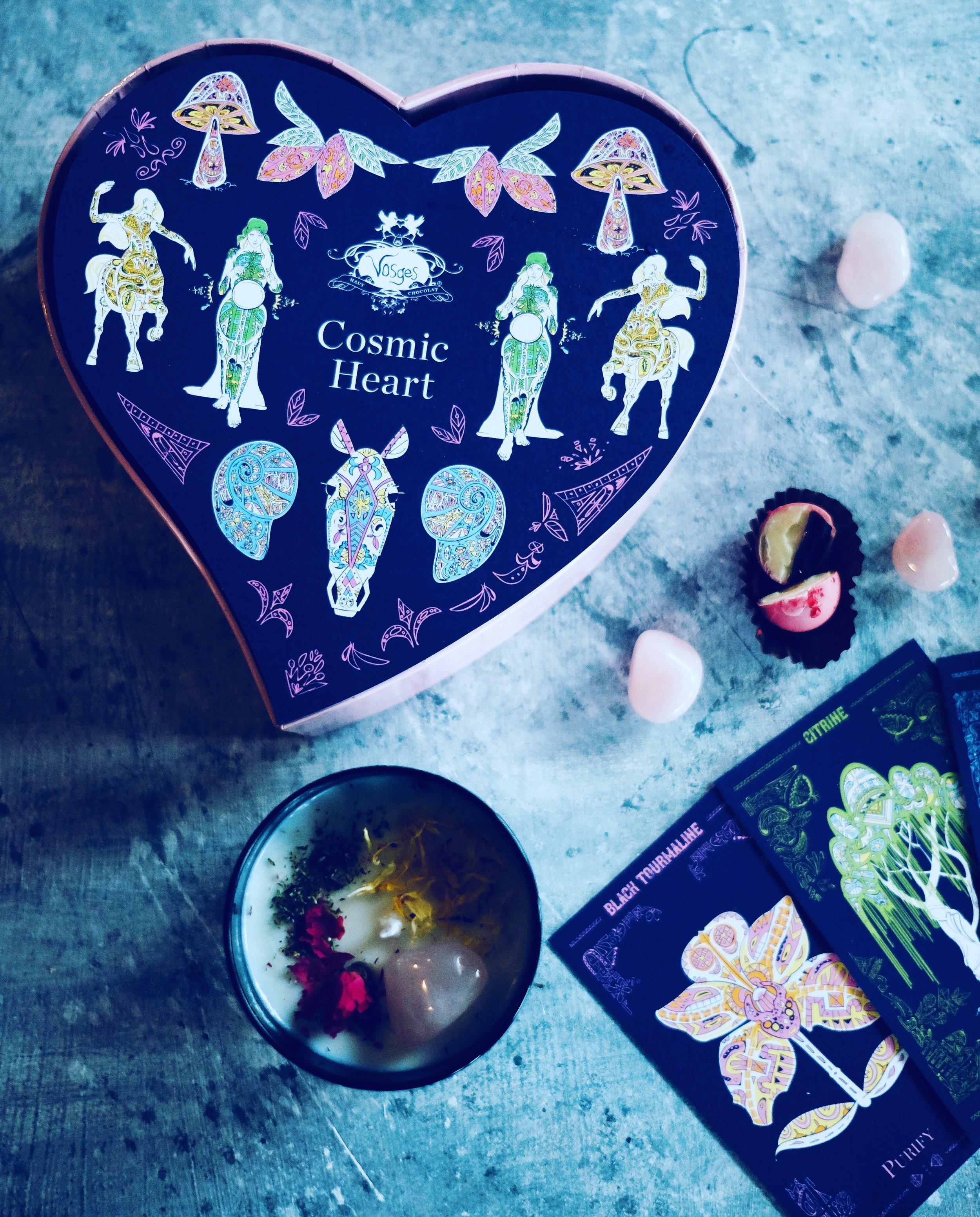 Pictured here Vosges Cosmic Heart Chocolate collection, Crystal Pairing cards & MARVEL + MOON Tenth Muse candle.