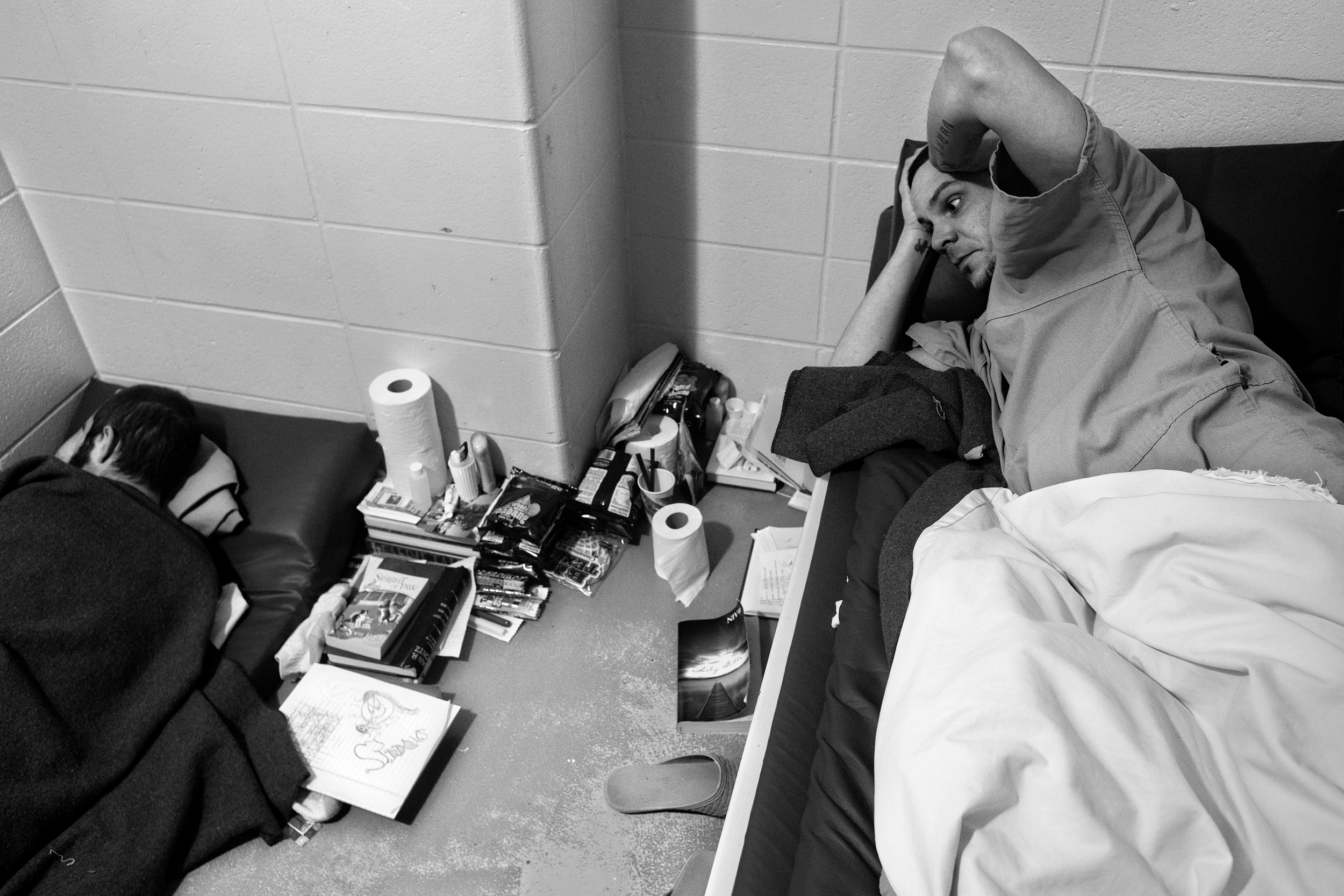 """Paul rests in his cell at the Dubois County Security Center where he was held for three months on felony theft charges before being transferred to a state mental health facility. Despite the fear of physical harm at Paul's hand, Lynda has mixed feelings about his incarceration. """"I don't like seeing him sit in jail,"""" she said. """"But at least I can sleep and at least I can watch TV and at least I can do what I want and I don't have to worry that he's hiding behind some closet door ready to kill me."""""""