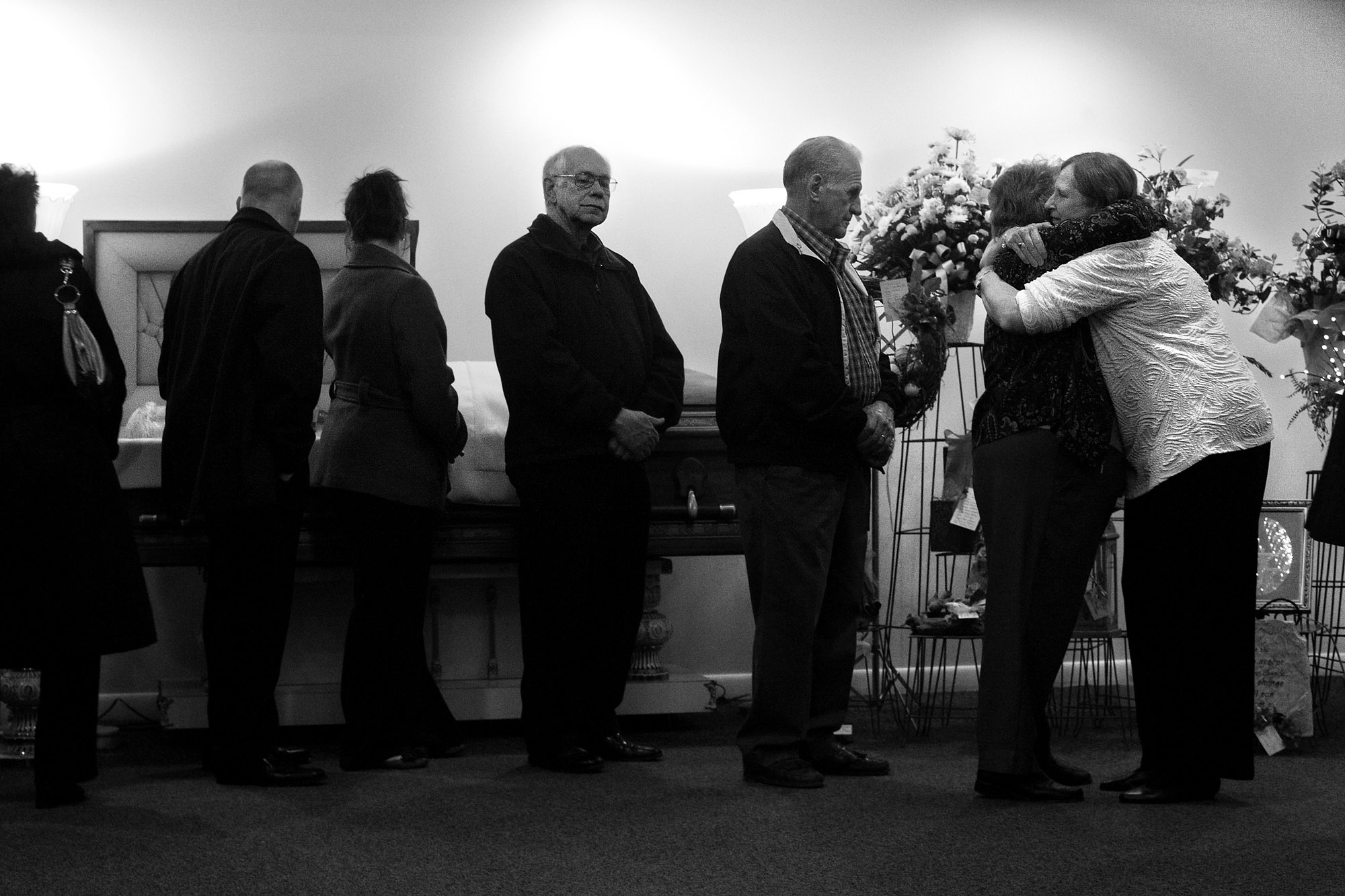 """For nearly nine hours, an estimated 1,200 visitors passed through Becher & Kluesner Downtown Chapel in Jasper to pay their respects to Red's wife, Bonnie, and the rest of his family. """"He didn't know a stranger,"""" Red's daughter Brooke Kendall said about her father."""