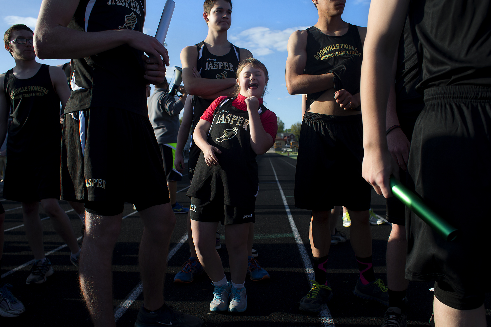 Jasper High School junior Amy Stork pumped a fist as she lined up for the 400-meter relay during the unified track meet between Jasper and Boonville at Jerry Brewer Alumni Stadium in Jasper. The meet was the first for the JHS unified track program, which allows special-needs students to participate in a sport and experience the social sector of athletics they may have otherwise missed as part of their typical school day.