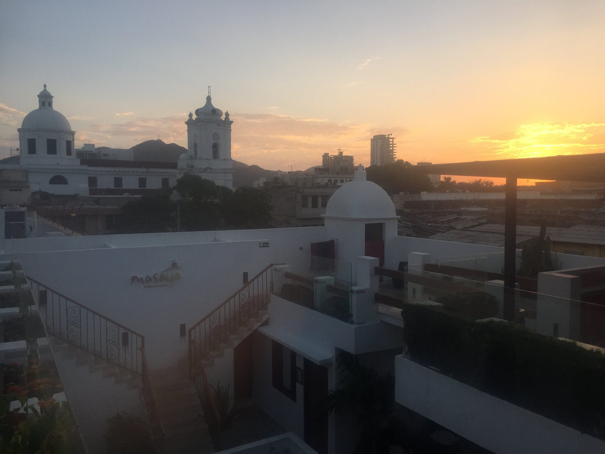 Masaya Hostel overlooking the Sierra Nevada de Santa Marta at dusk.