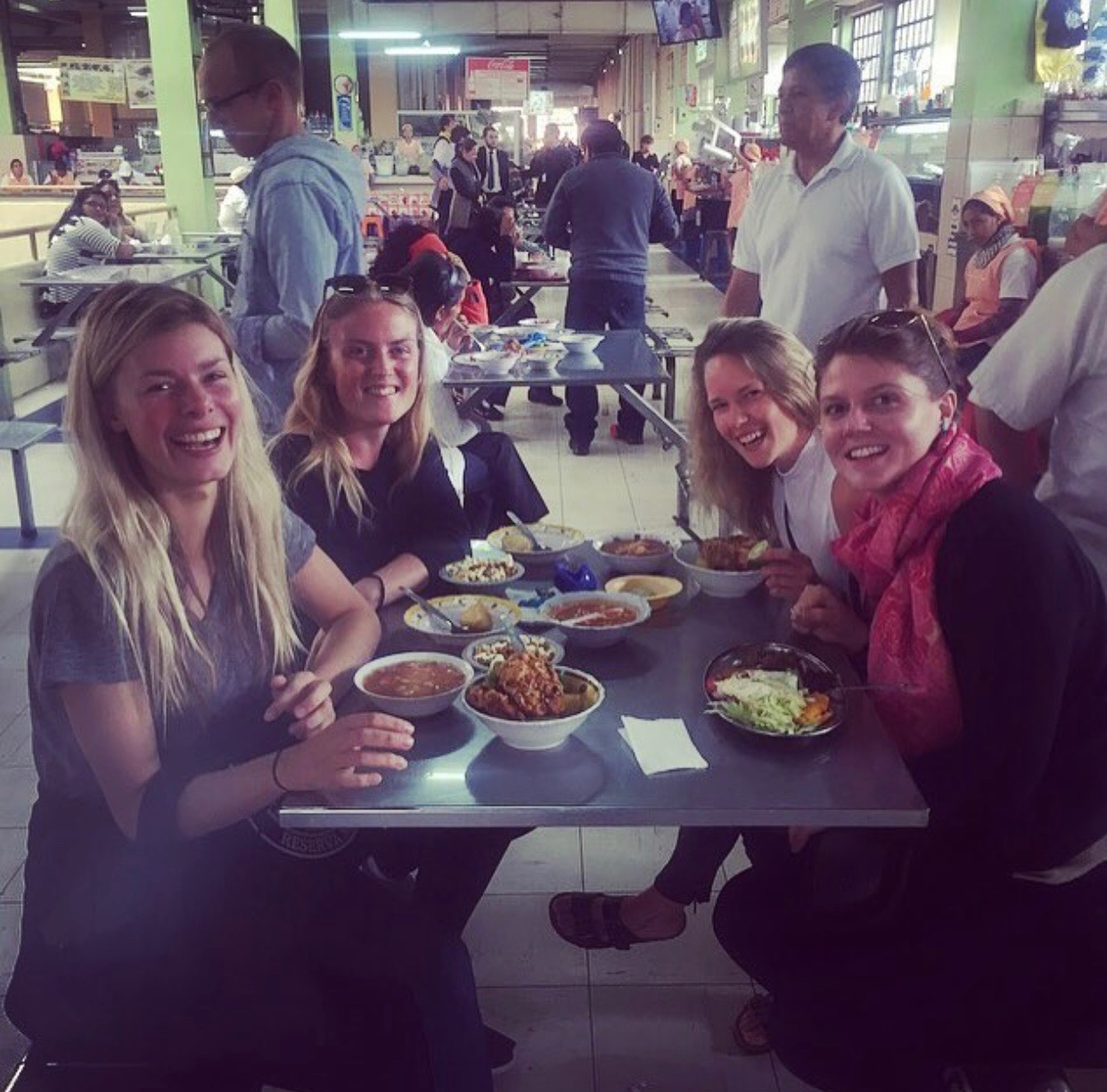 Enjoying a meal with friends from Community at Mercado Central.