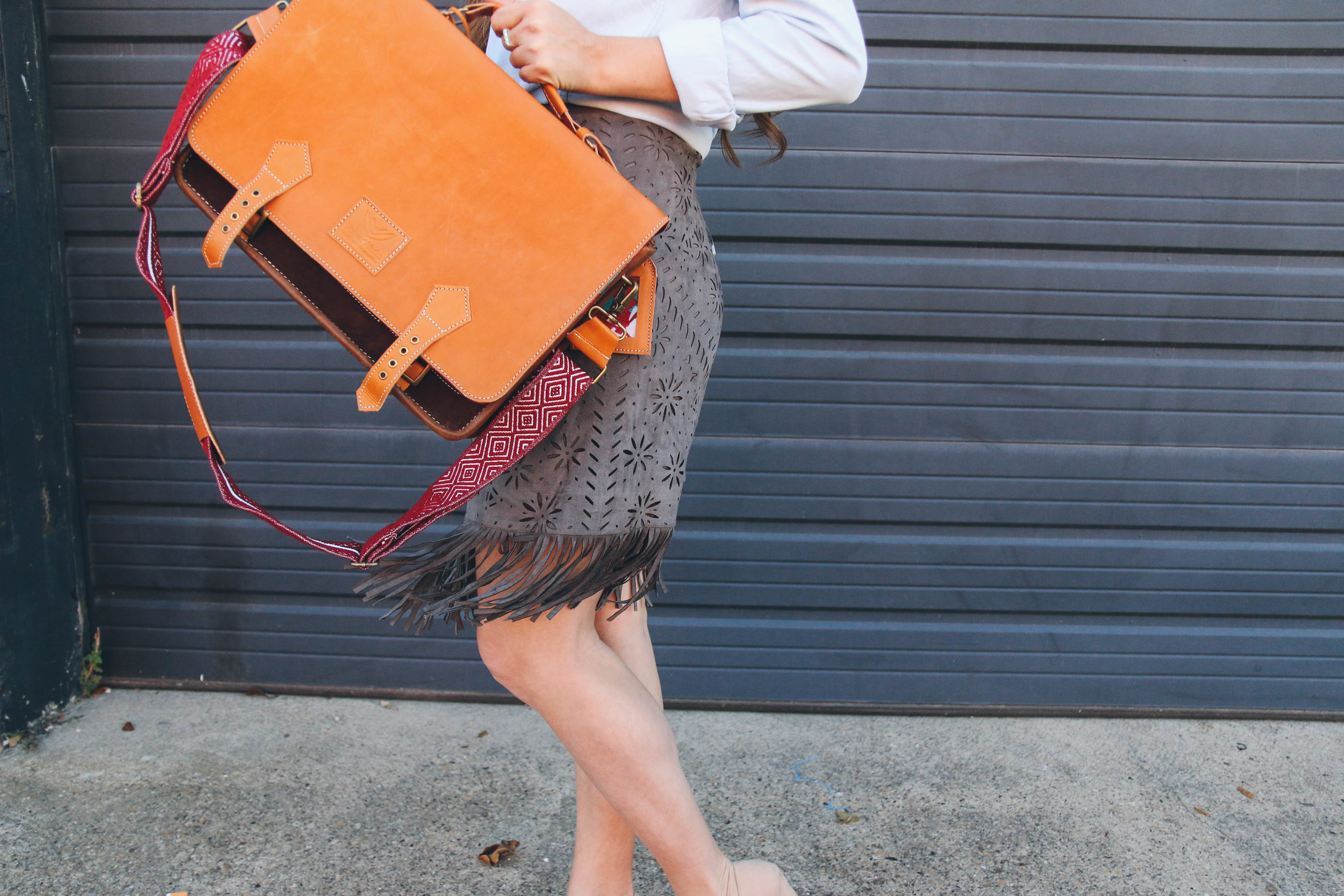 The same  Garnet Messenger , featuring colorful woven strap.