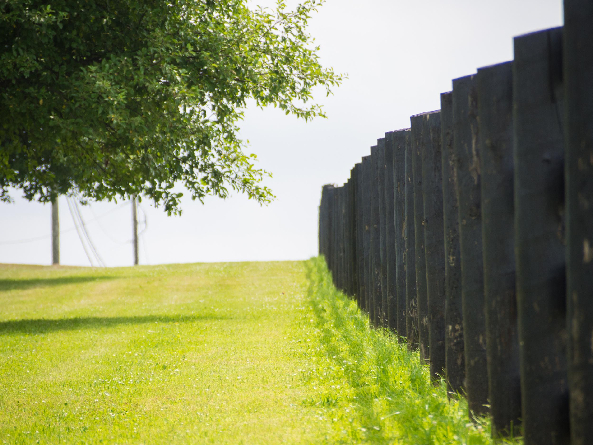 Black fencing along Rock R