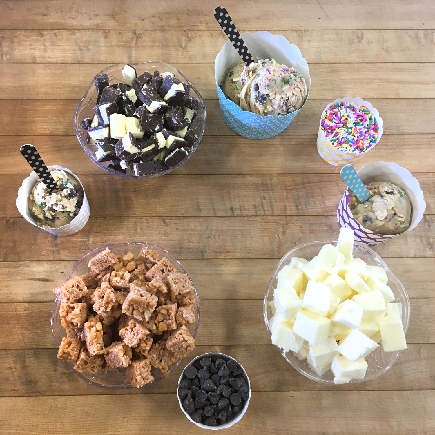 INTRODUCING - Doughlicious: a completely edible and bakeable cookie dough!We have been working on this project for almost a year!! So happy to finally be announcing this to our Shop Family. Pop into The Shop to get your taste of our rotating selections!Make sure to grab a punch card to get your 10th bowl free!