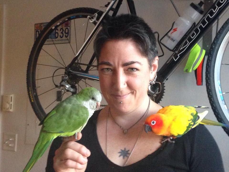 Our founding Quaker/Monk parrot Maxine was adopted and gained a loving mom and sister (sun conure) in October 2015!