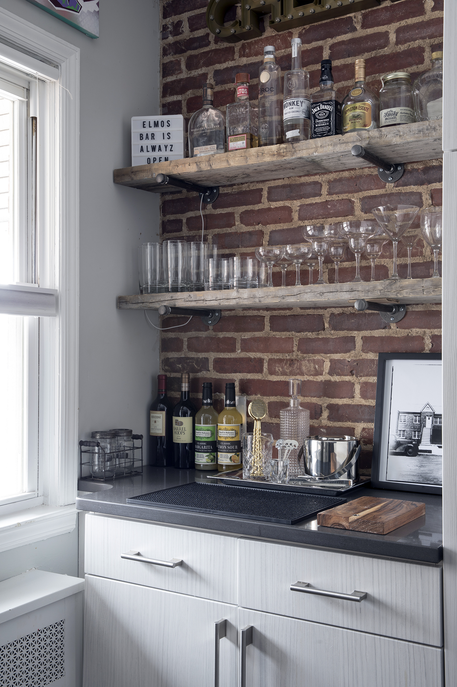 rustic modern industrial brick wall open shelves home bar.jpg