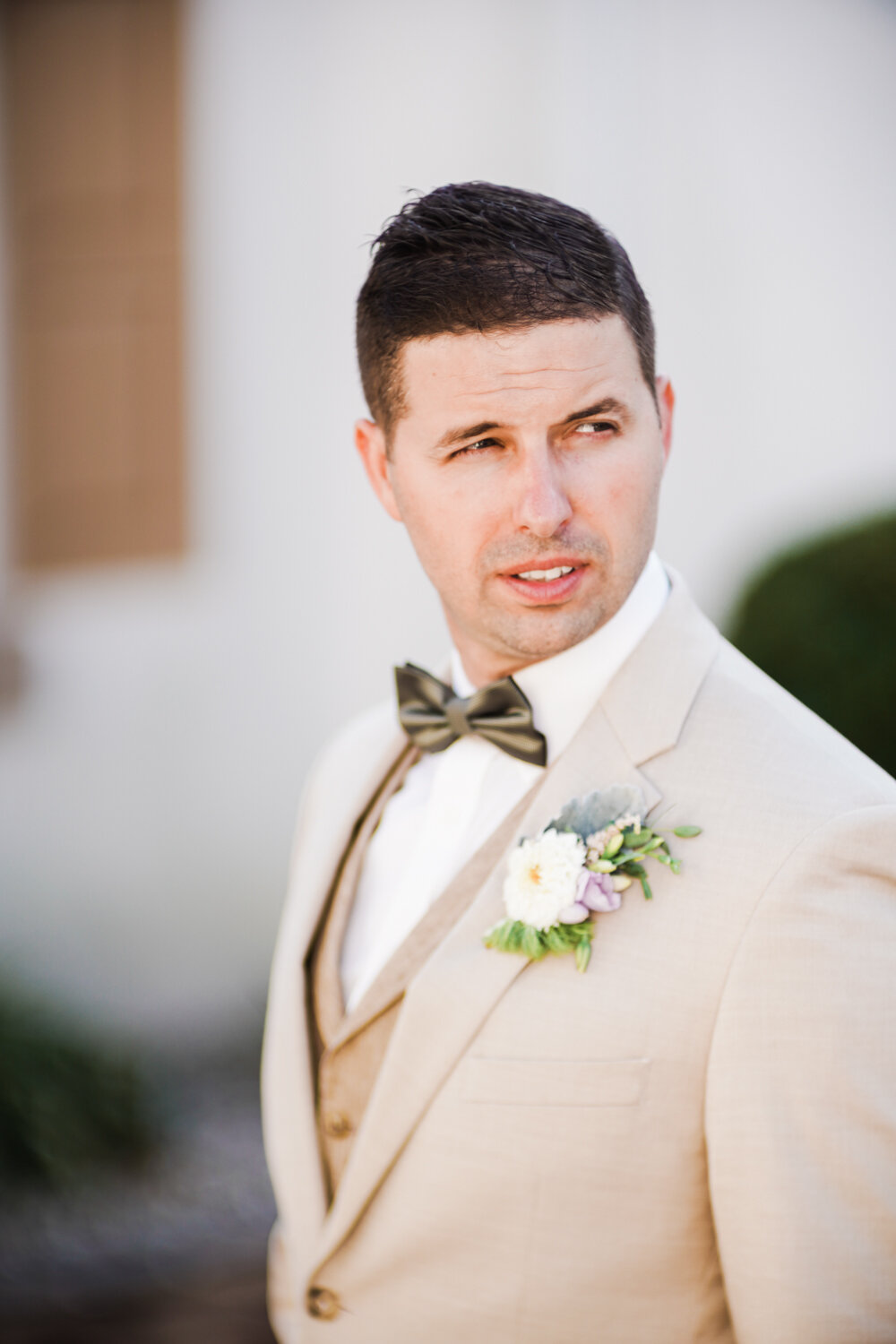 Candid image of a groom at a wedding