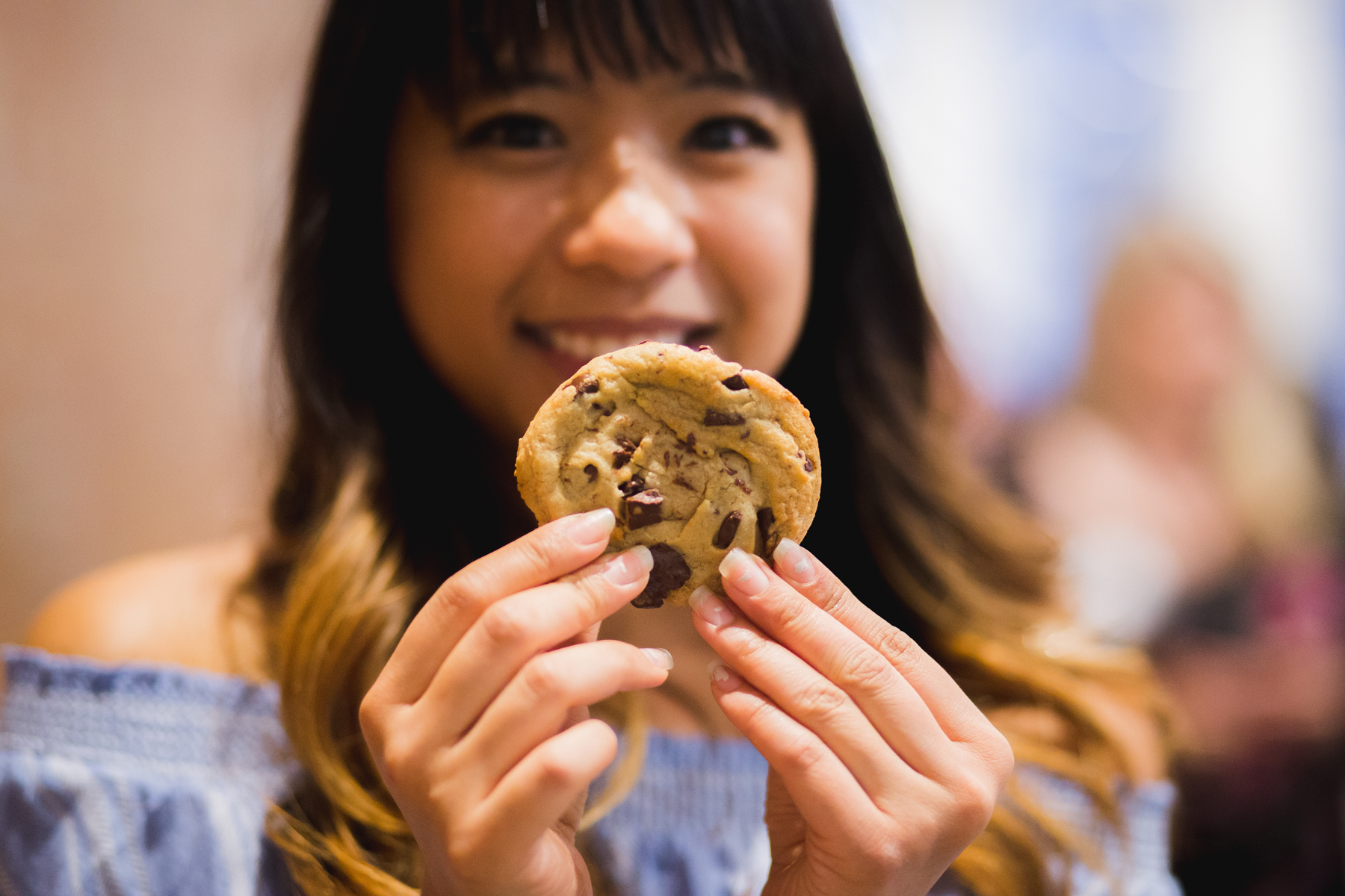 Melissa with one of the delicious chocolate chip cookies from Insomnia Cookies. || Photo by  Tim Becker Photography