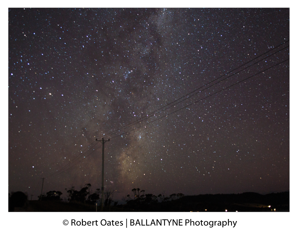 Is there anyone out there? Telegraph lines lead up to the Milky Way over Howden, Tasmania