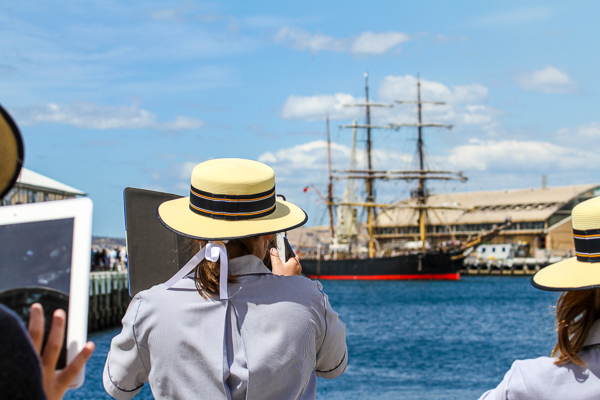 Cover Image: School Girls capture the arrival of the old (Tall Ship - James Criag) with the new. ©Mary Lincoln | Courtesy of the Australian Wooden Boat Festival
