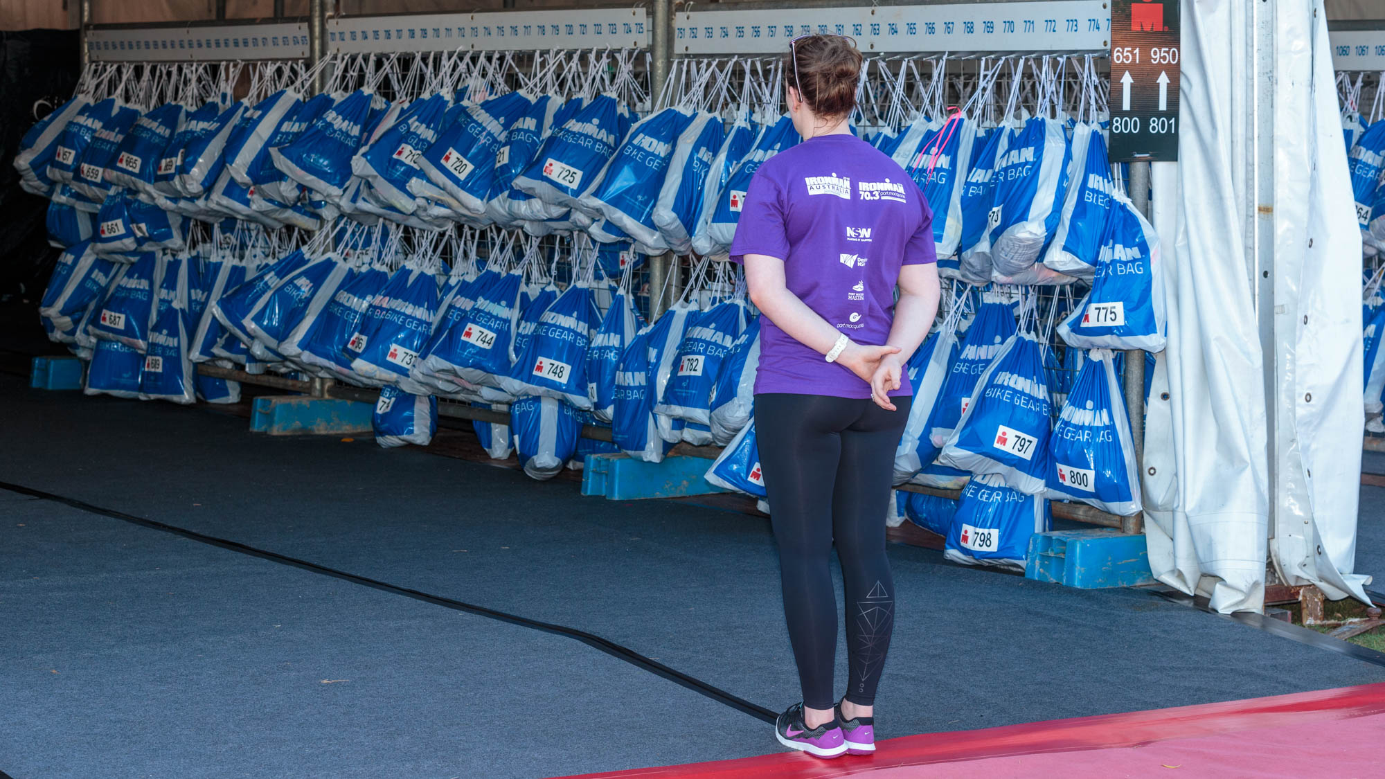 Competitor packs fill a tent of their own. Volunteers assist in finding them all.