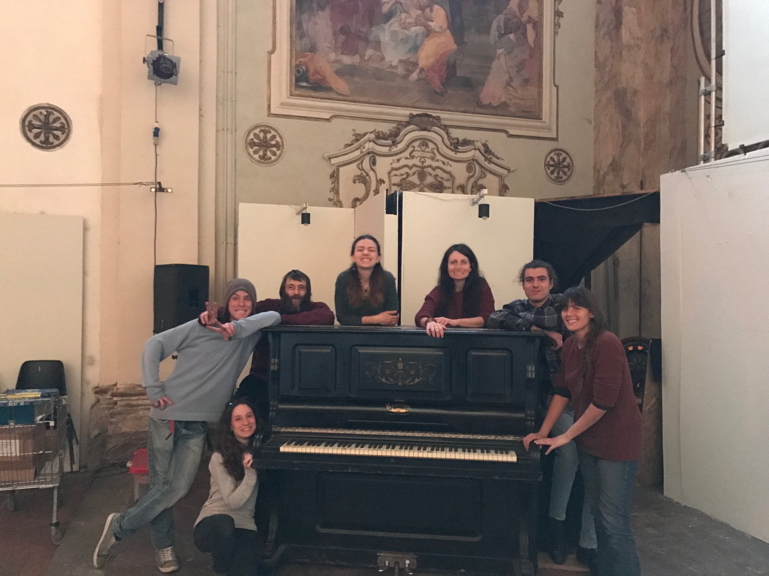 The group of volunteers who put on our show in Pisa, triumphant after relocating the piano for us