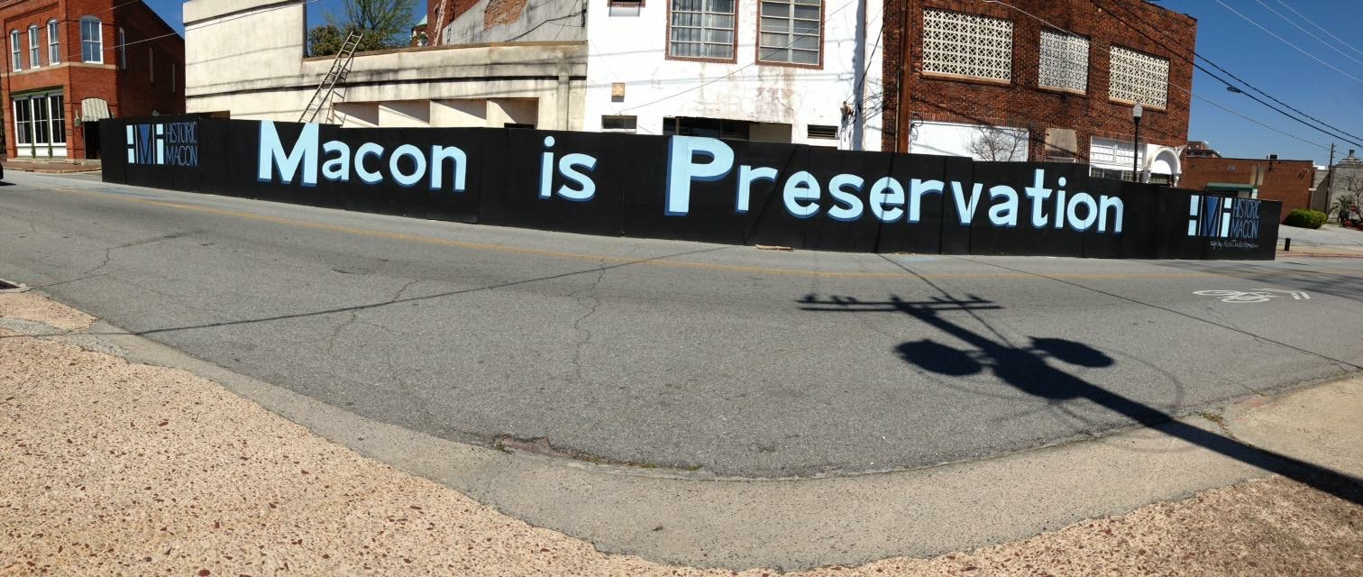 Temporary sign painted on a construction wall in front of the Capricorn Records offices currently on Walton Way/Cotton Ave for Historic Macon. 2016.