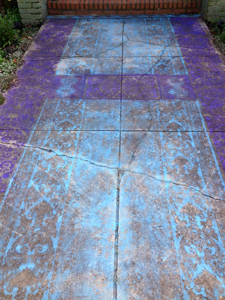 I painted my front walkway to look like a pretty Oriental rug.