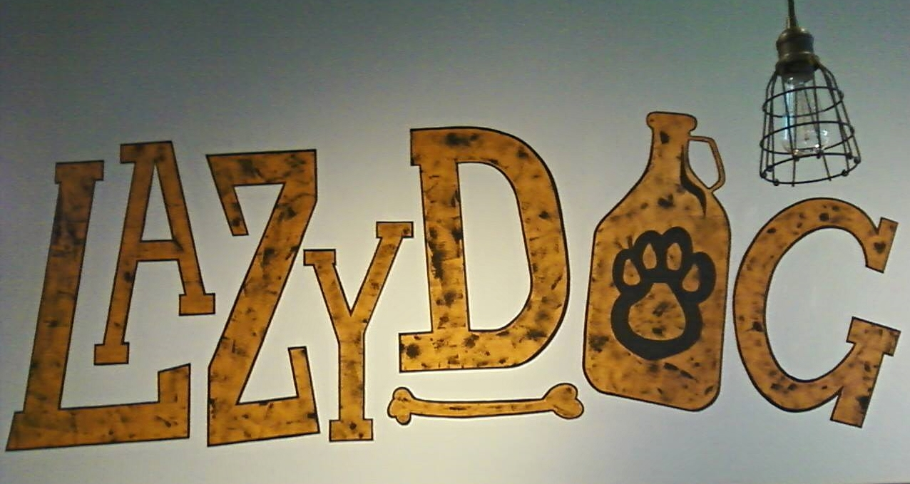 Logo painted on the wall at Just Tap'd, formerly known as LazyDog Growler.
