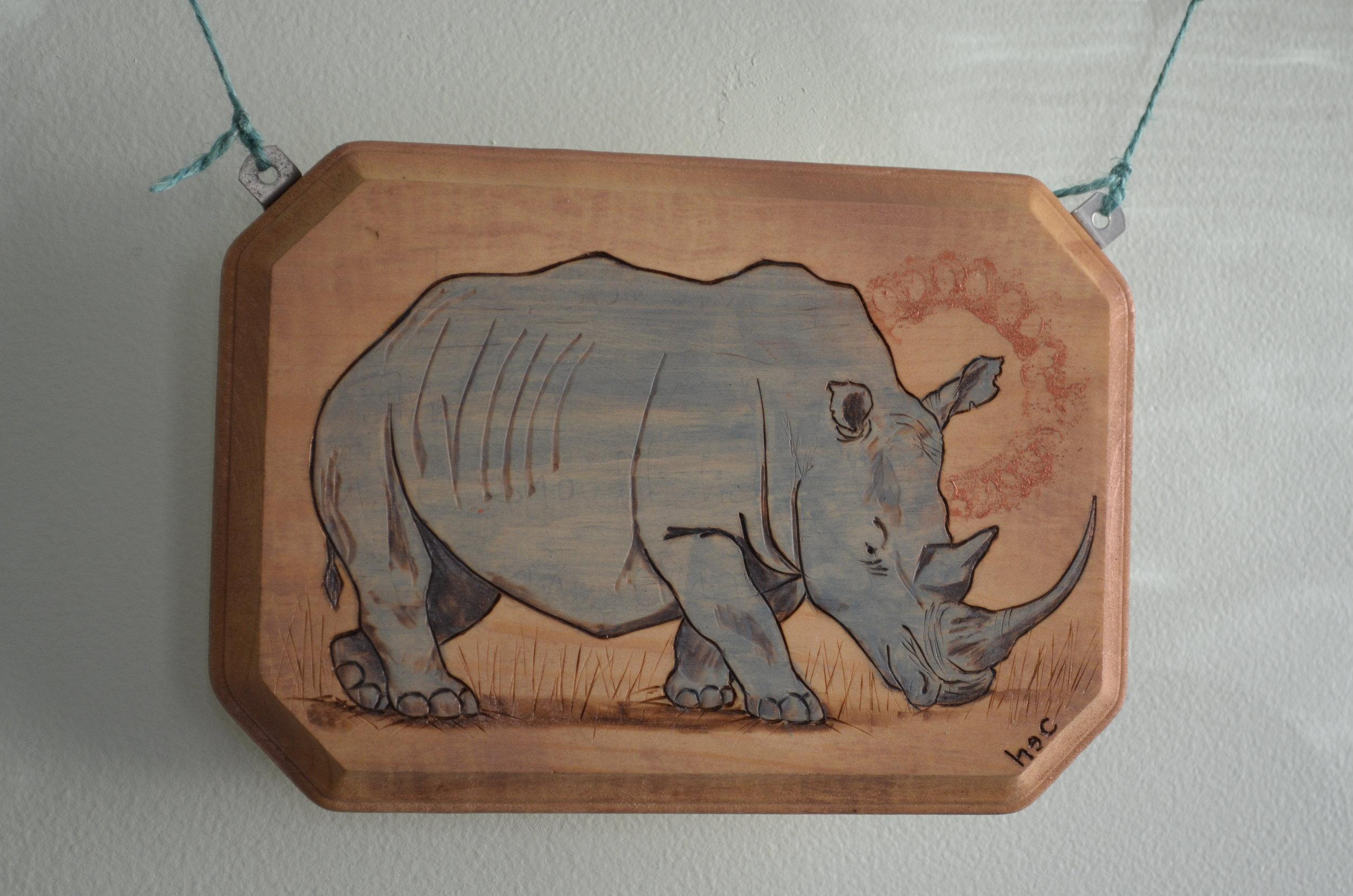Chubby Unicorn. pyrography,wood, acrylic paint, twine, glass and wooden beads, hardware. 2016.