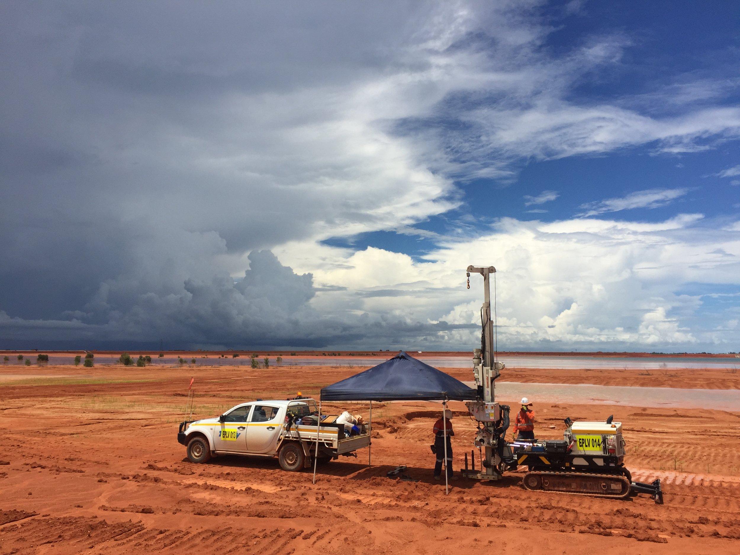 Geoprobe on tailings with storm.JPG